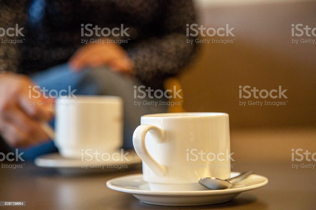drinking coffee while social gethering stock photo