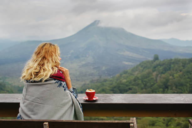 Drinking coffee with mountain view stock photo