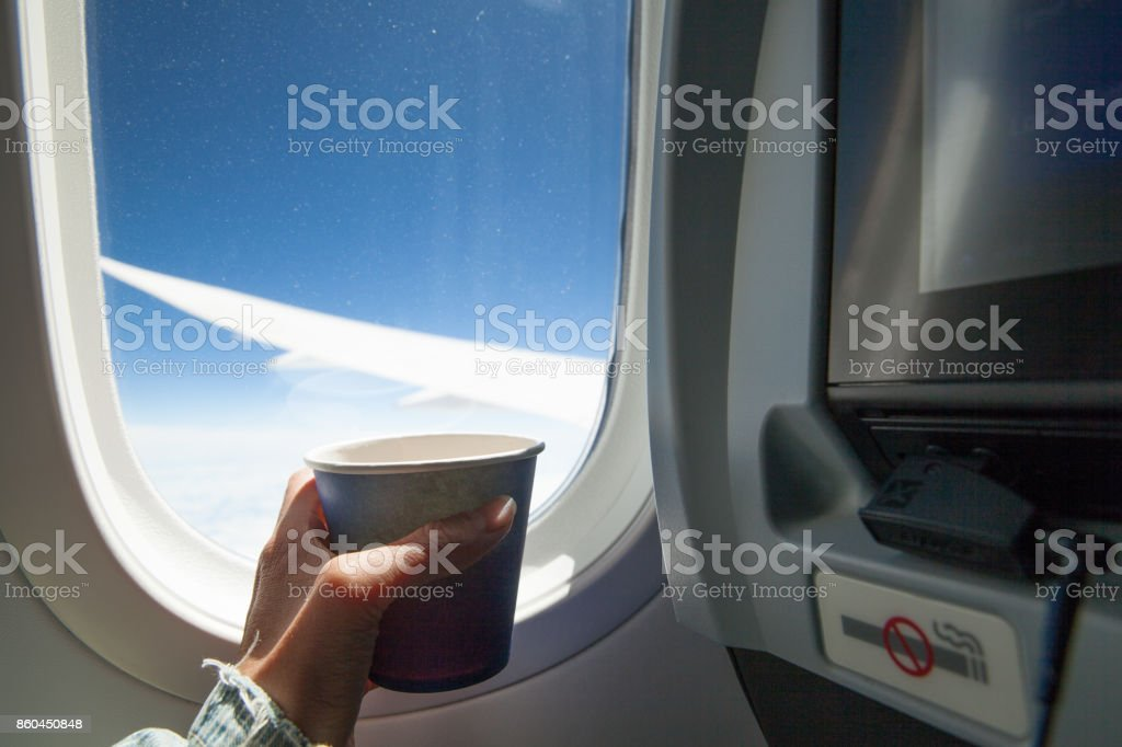 Drinking coffee/tea on a plain stock photo