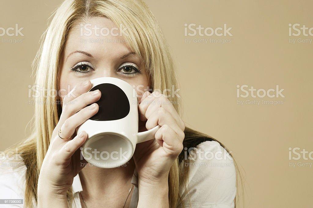 Drinking from a cup royalty-free stock photo