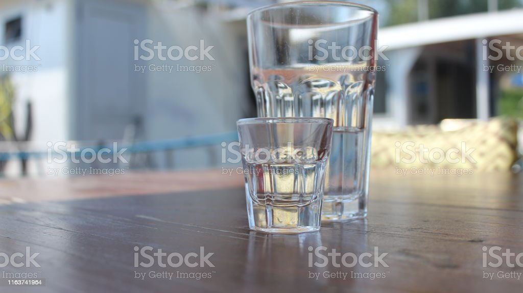 Different angles on a big drinking glass of mineral water with lemon