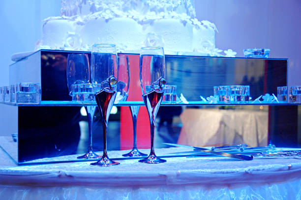 Drinking Glasses Beautiful table with two wedding decorated champagne tubes. chinese wedding dinner stock pictures, royalty-free photos & images
