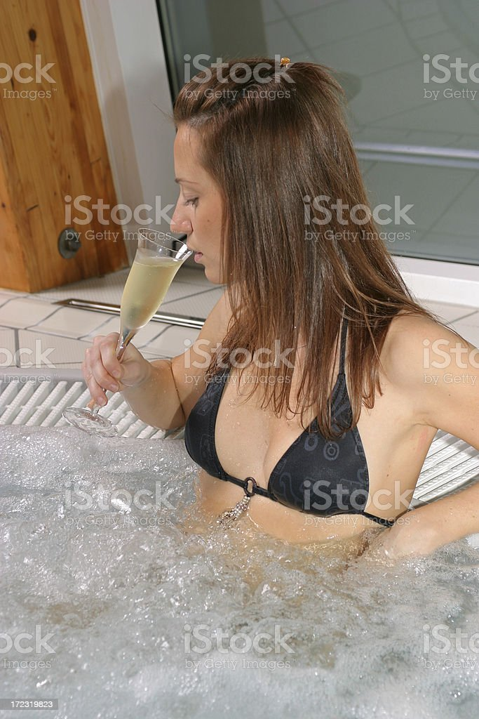 Drinking in jacuzi royalty-free stock photo