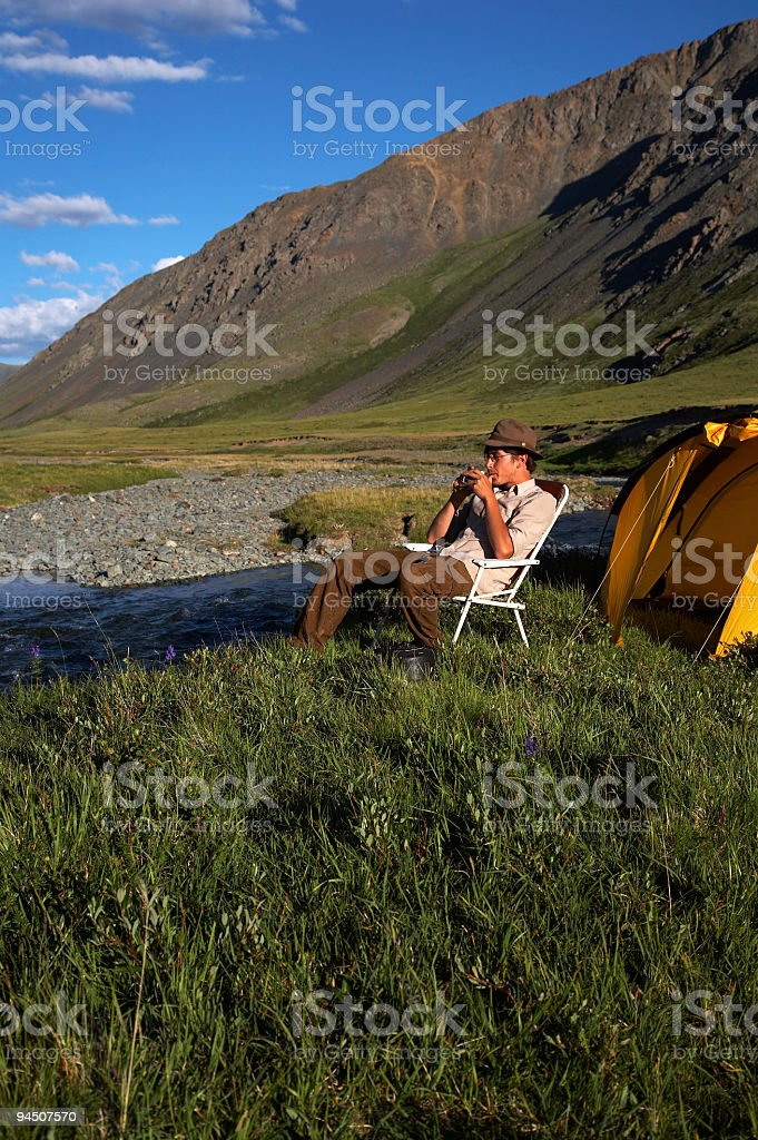 drinking man near the stream royalty-free stock photo