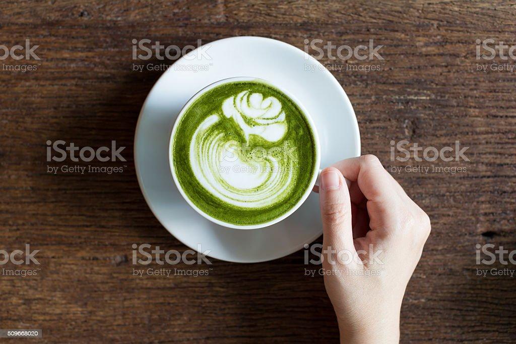 Drinking match Latte stock photo