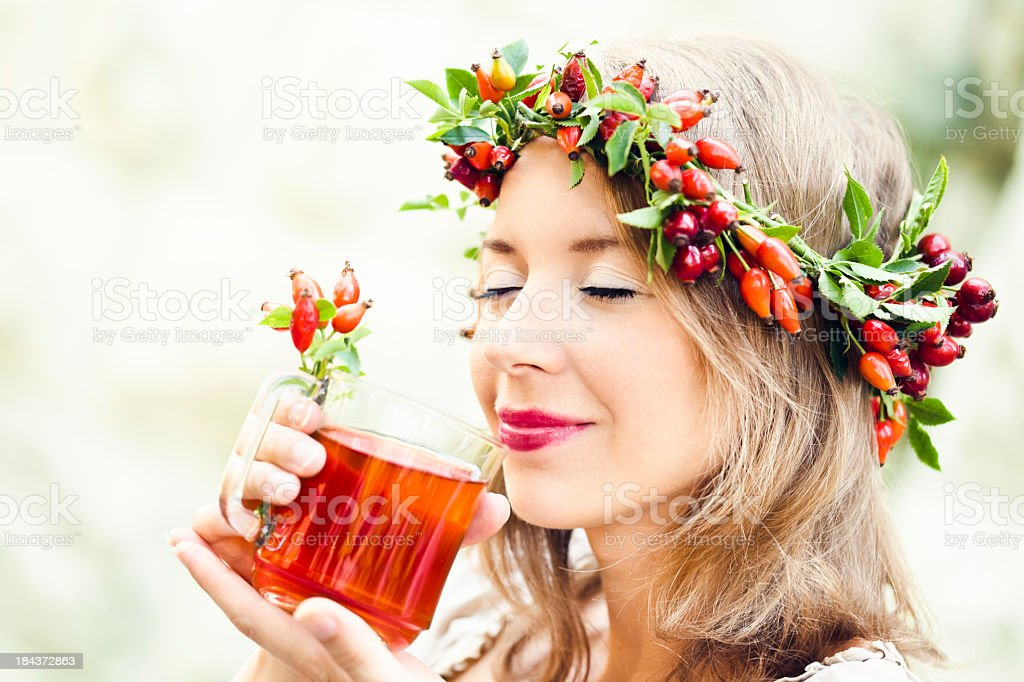 Drinking rosehip juice stock photo