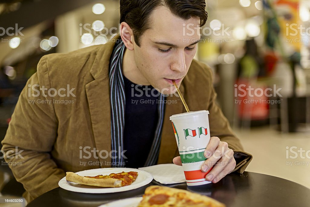 Drinking Soda with Pizza stock photo