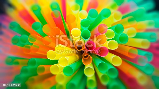 istock drinking straw background 1073002638