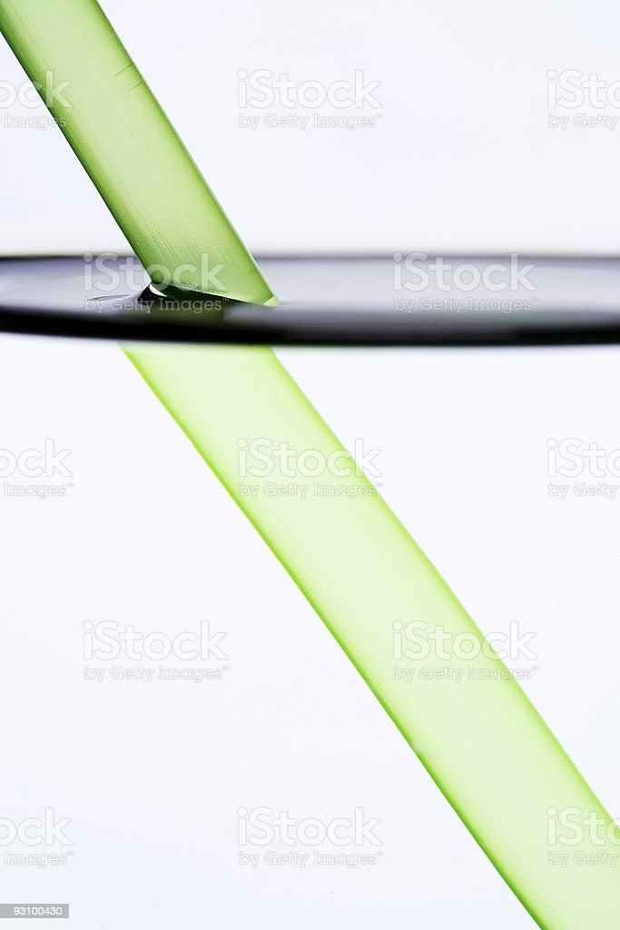 Drinking straw refracted by water stock photo