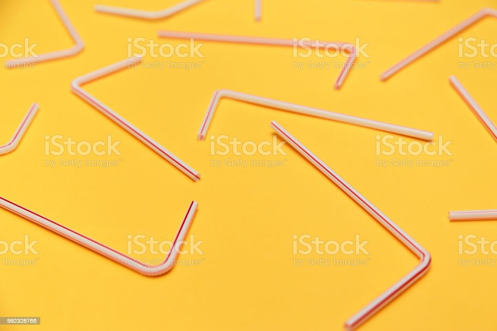 Drinking straws for party on yellow background. Top view stock photo
