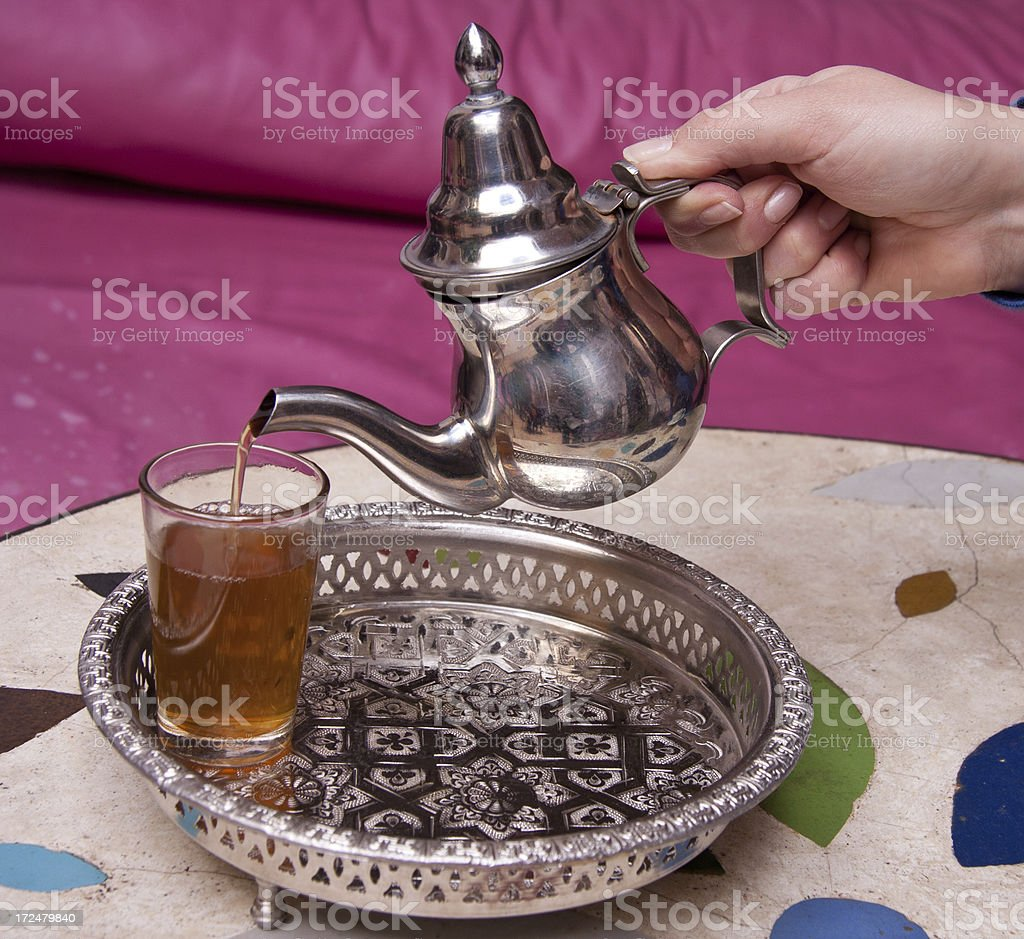 Drinking traditional mint tea in Marrakesh royalty-free stock photo