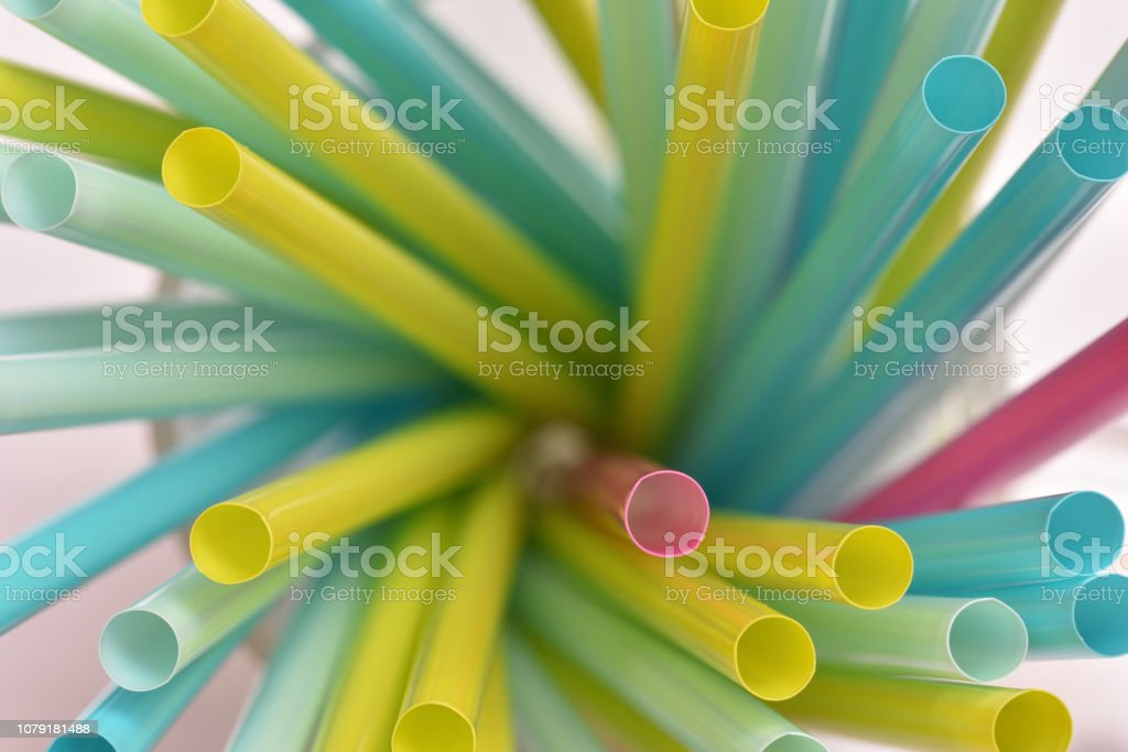 Drinking tubes. Multicolored plastic tubes for drinking beverages stock photo
