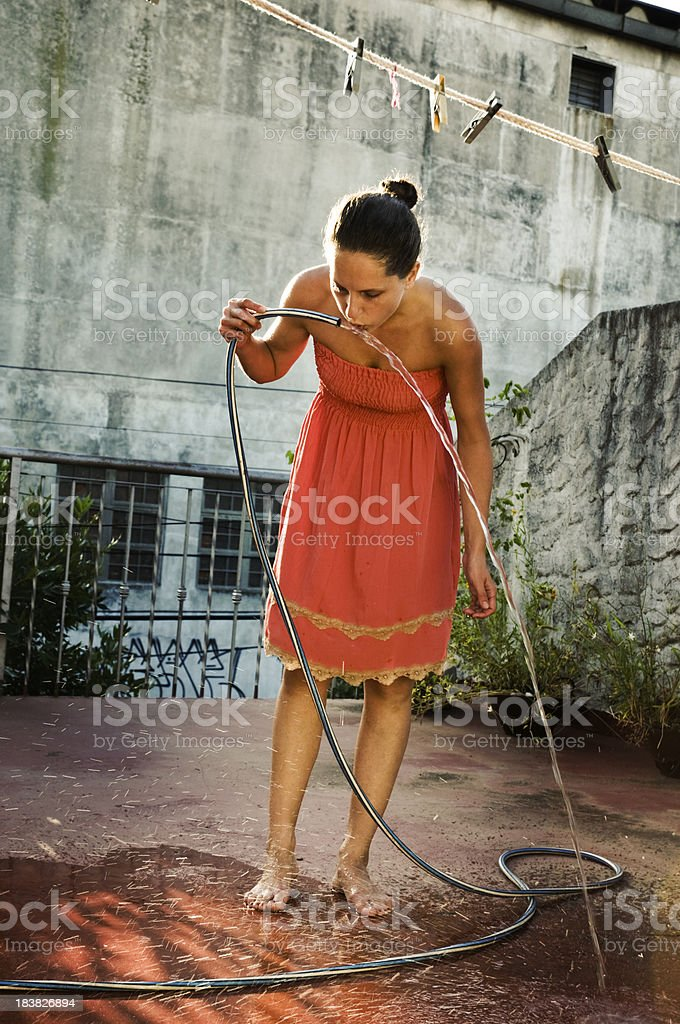 drinking water from hose royalty-free stock photo