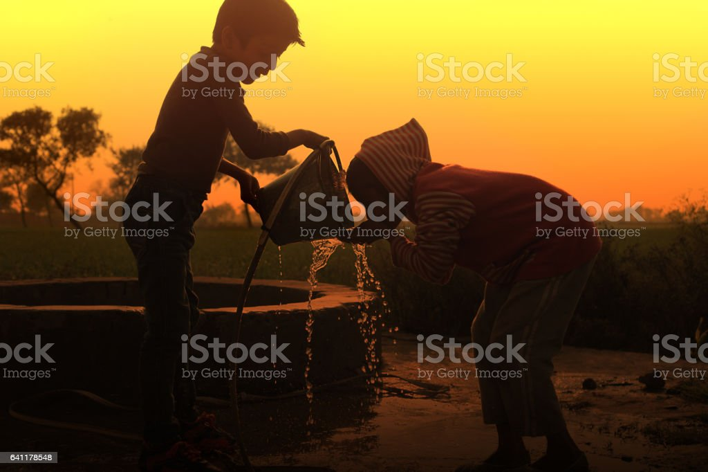 Drinking water on water well stock photo
