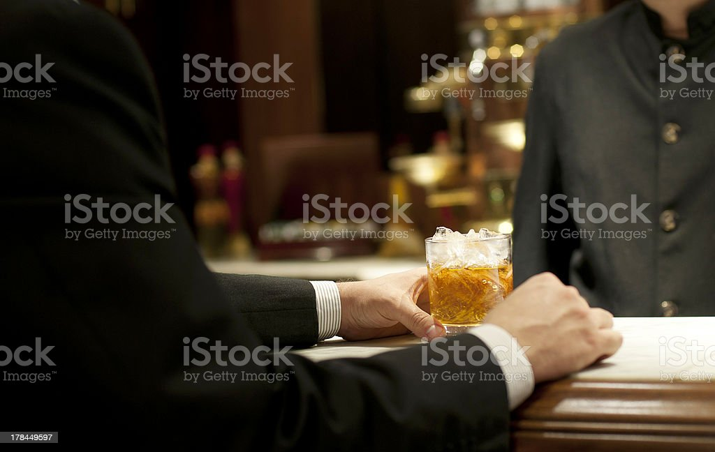 Drinking whiskey at the bar stock photo