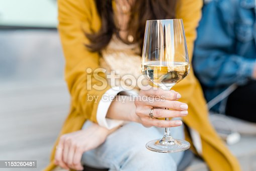 Drinking white wine in the city