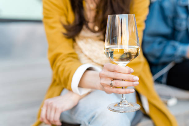 Drinking white wine in the city Drinking white wine in the city white wine stock pictures, royalty-free photos & images