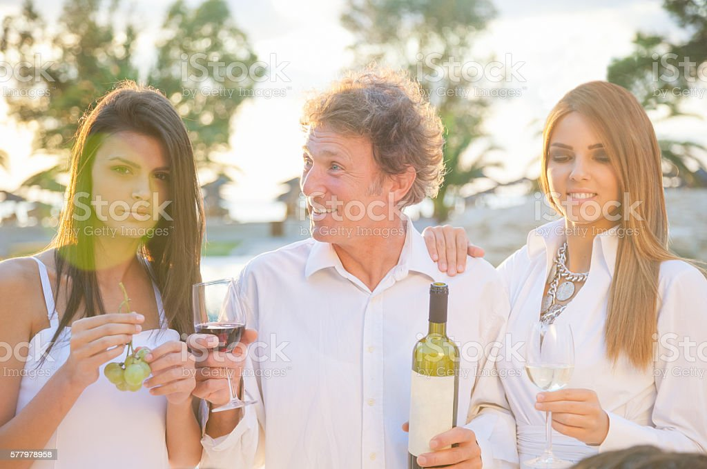 Drinking wine at party stock photo