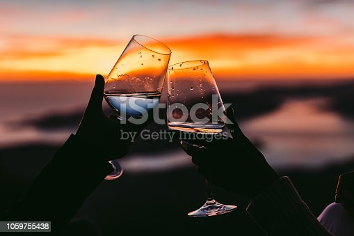 drinking wine at sunset with beautiful view