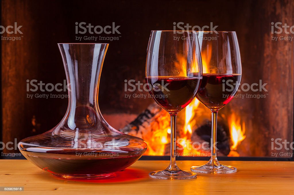 drinks at fireplace in winter stock photo