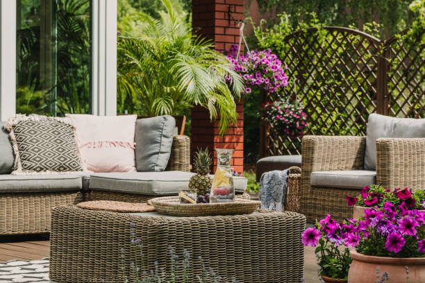 Drinks on wicker coffee table cute patio with comfy sofa stock photo