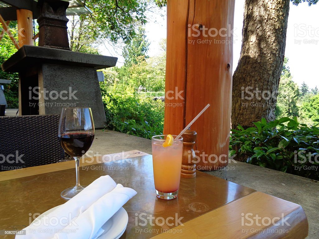 Drinks outdoors next to fireplace stock photo
