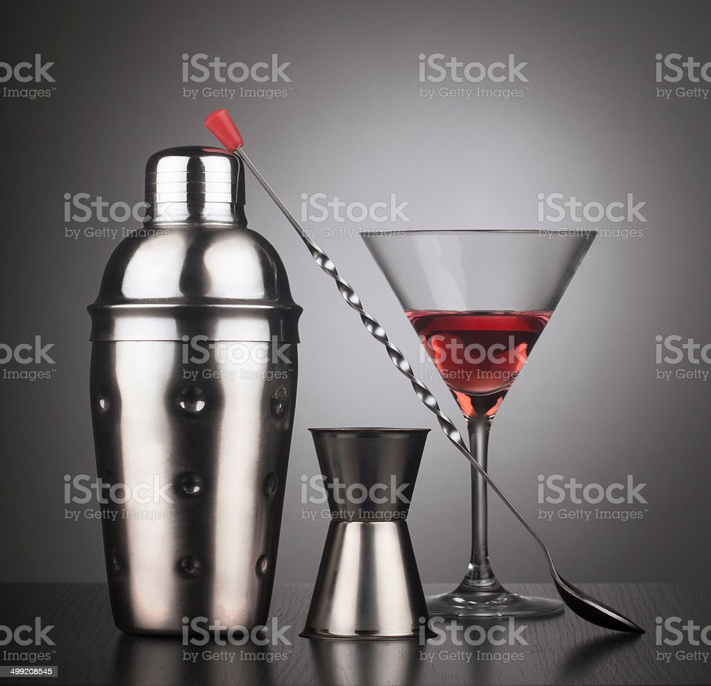 Drinks shaker with cocktail tools and glass stock photo