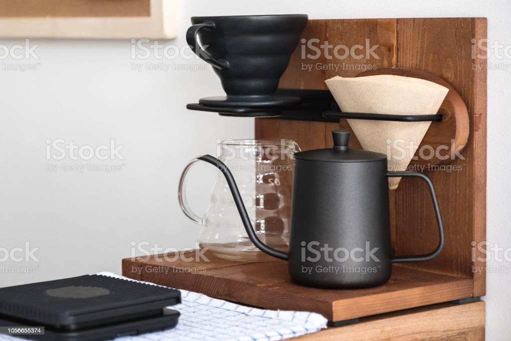 Drip coffee equipment in vintage wooden cafe