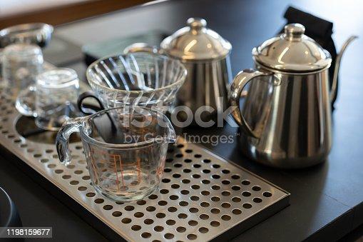 Drip coffee equipment set. Goose Neck Kettle, Measuring Jug, Plastic Filter Cone.