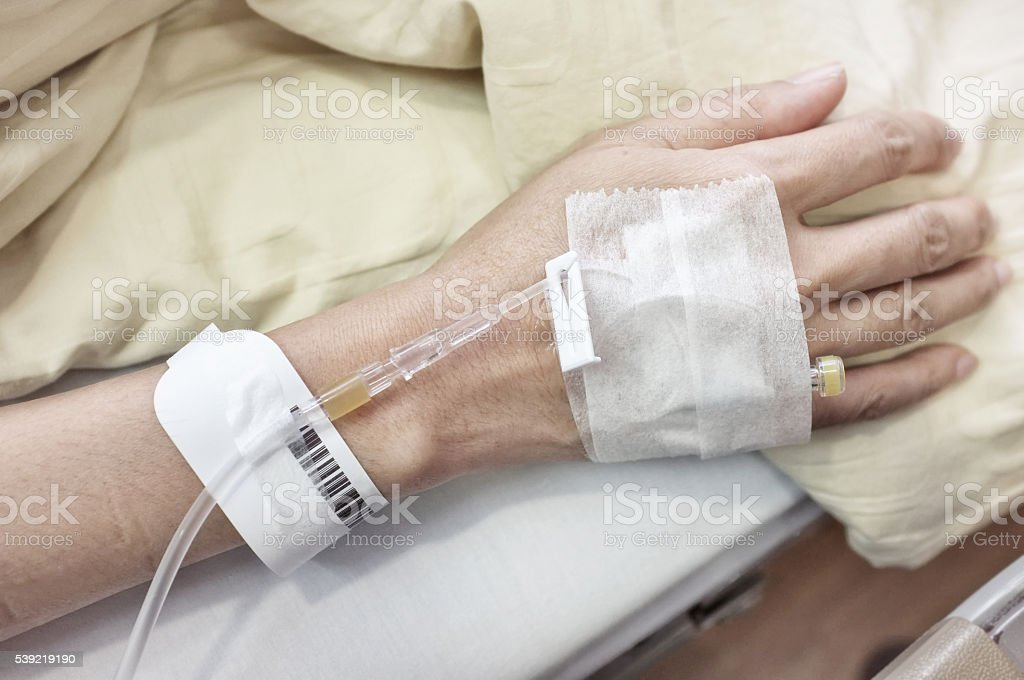 IV drip in patient's hand stock photo