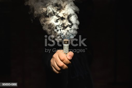 istock Dripper in one hand making a cloud of fume 956954986