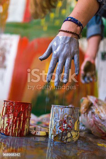 Young beautiful woman painting an image on the wall