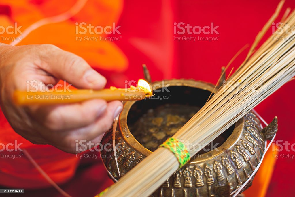 Dripping drop while religious ceremony stock photo