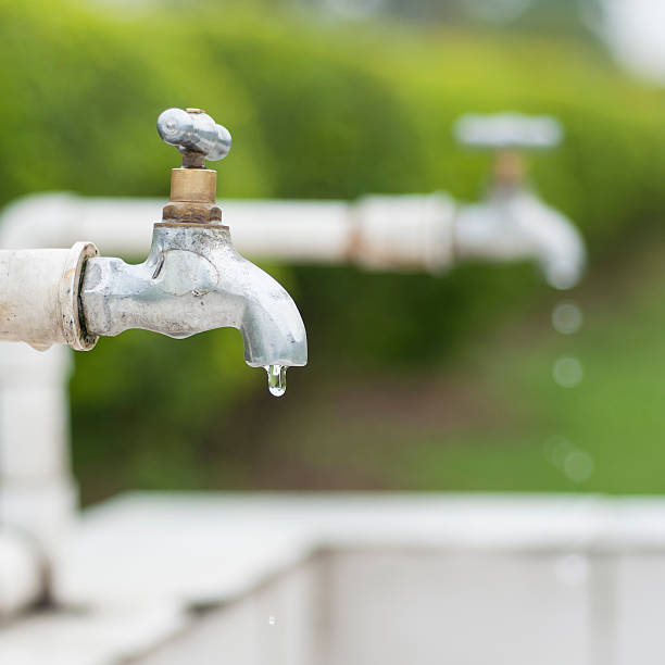 Dripping faucet. Dripping faucet. water wastage stock pictures, royalty-free photos & images