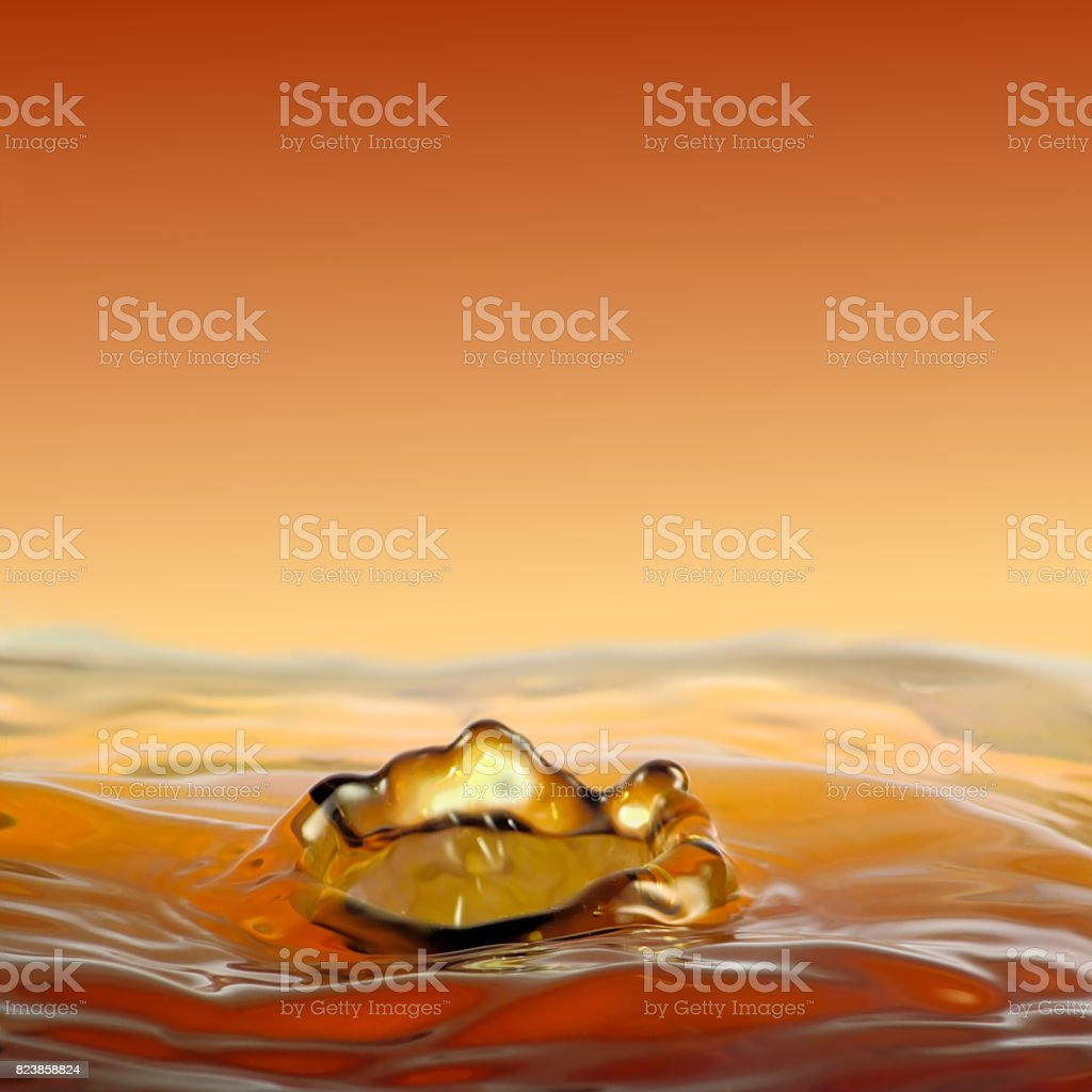 Dripping golden fluidity, a crown of water. stock photo