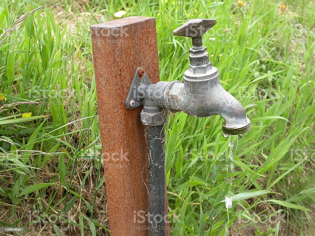 Dripping tap outdoors royalty-free stock photo
