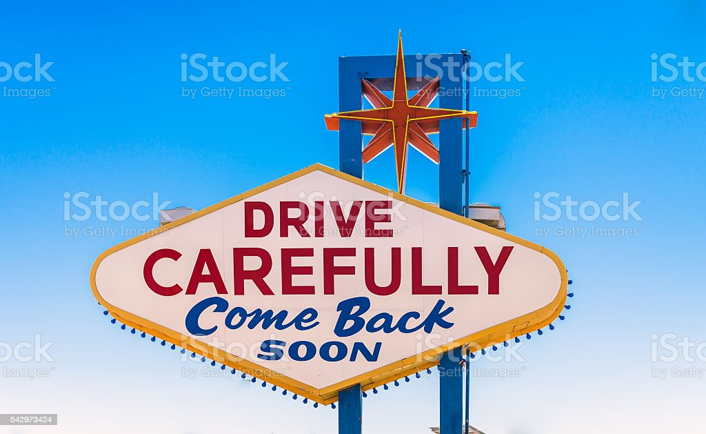drive carefully, come back soon sign exiting Las Vegas stock photo