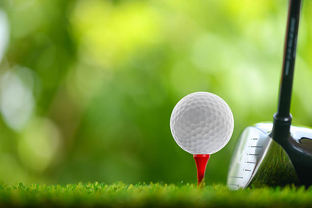 drive golf drive a golf ball on tee golf ball stock pictures, royalty-free photos & images