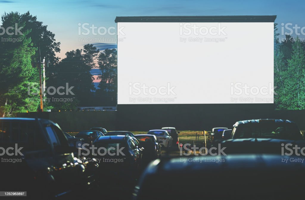Drive In Movie Movie goers enjoy a drive in movie for the first time in 2020. Long exposure. 2020 Stock Photo