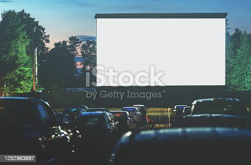 Movie goers enjoy a drive in movie for the first time in 2020. Long exposure.