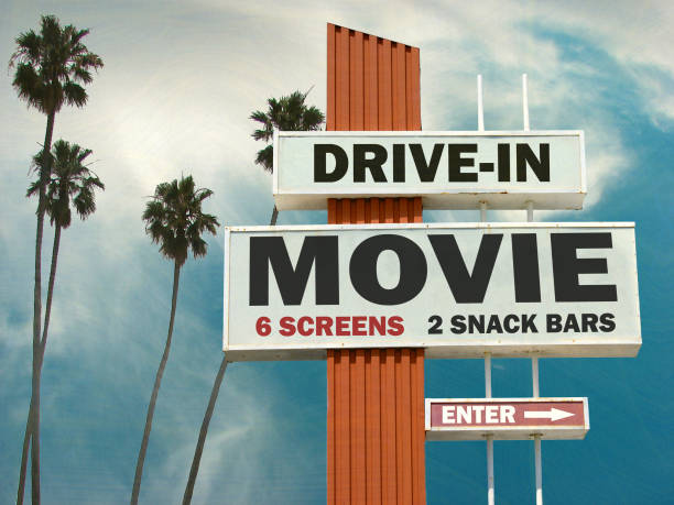 drive in movie sign aged and worn drive in movie sign with palm trees theater marquee commercial sign stock pictures, royalty-free photos & images