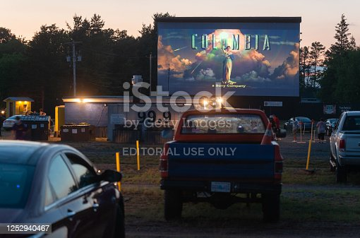 Cambridge, Canada - June 26, 2020 - Movie goers enjoy a screening of Jumanji at the Valley Drive In movie theatre on its opening night in the aftermath of the COVID-19 pandemic.  The theatre practiced social distancing at the onsite canteen & increased distances between vehicles.