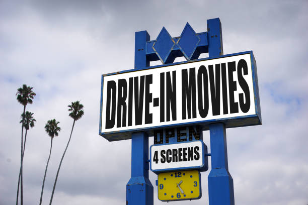 drive in movies aged and worn drive in movies theater marquee commercial sign stock pictures, royalty-free photos & images