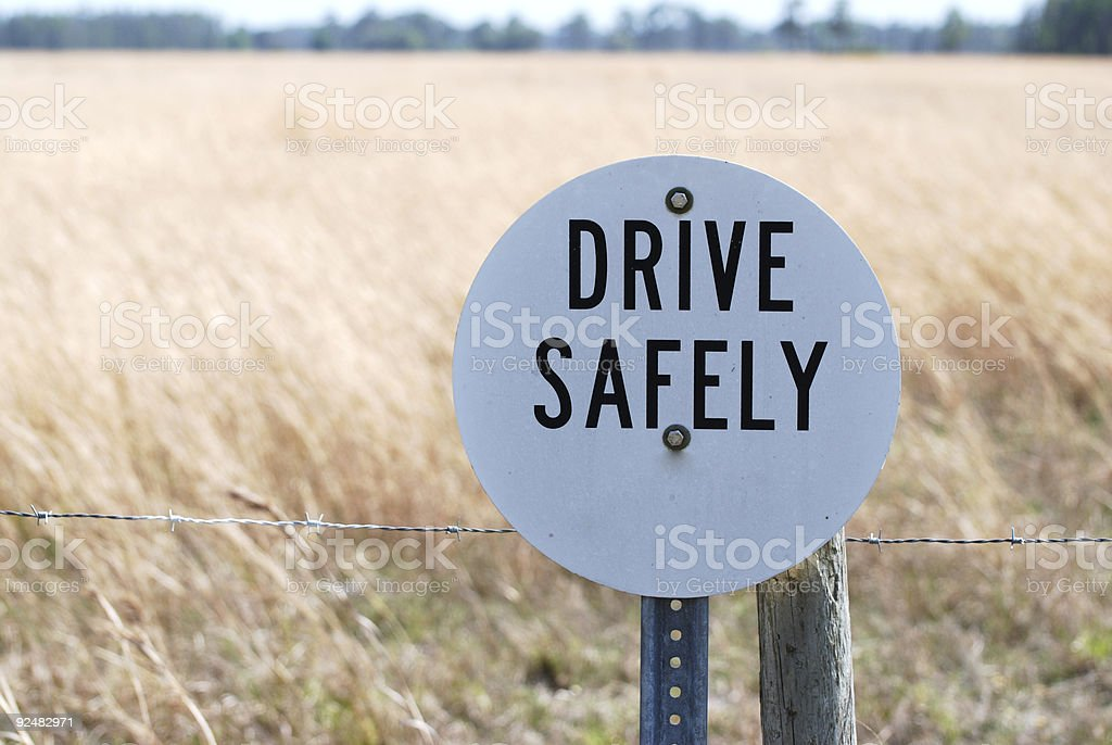 Drive Safely sign in front of a grain field royalty-free stock photo