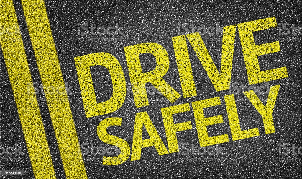Drive Safely written on the road stock photo