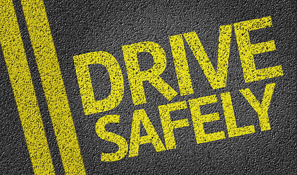 Drive Safely written on the road Drive Safely written on the road safe security equipment stock pictures, royalty-free photos & images
