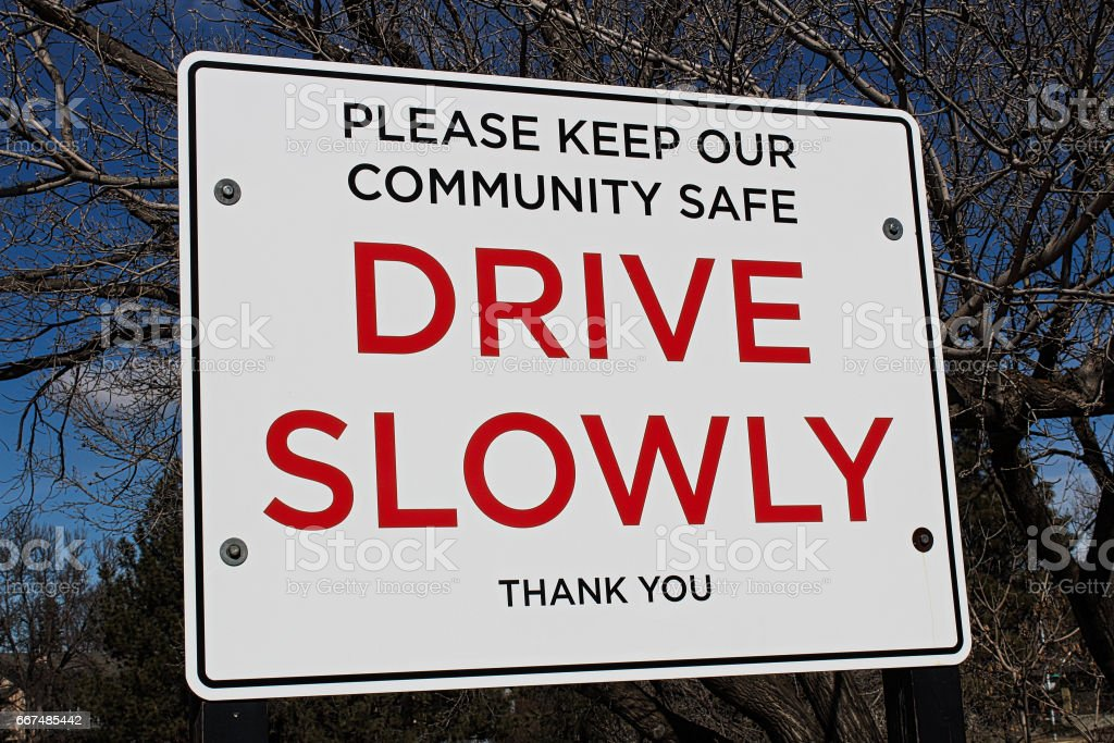 Drive slowly sign in a community area stock photo
