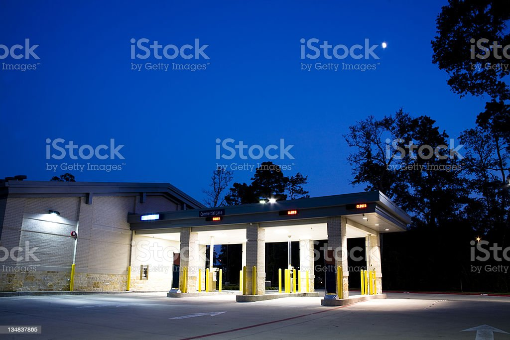 Drive in bank at dusk. The moon can be seen in the sky overhead. MORE...