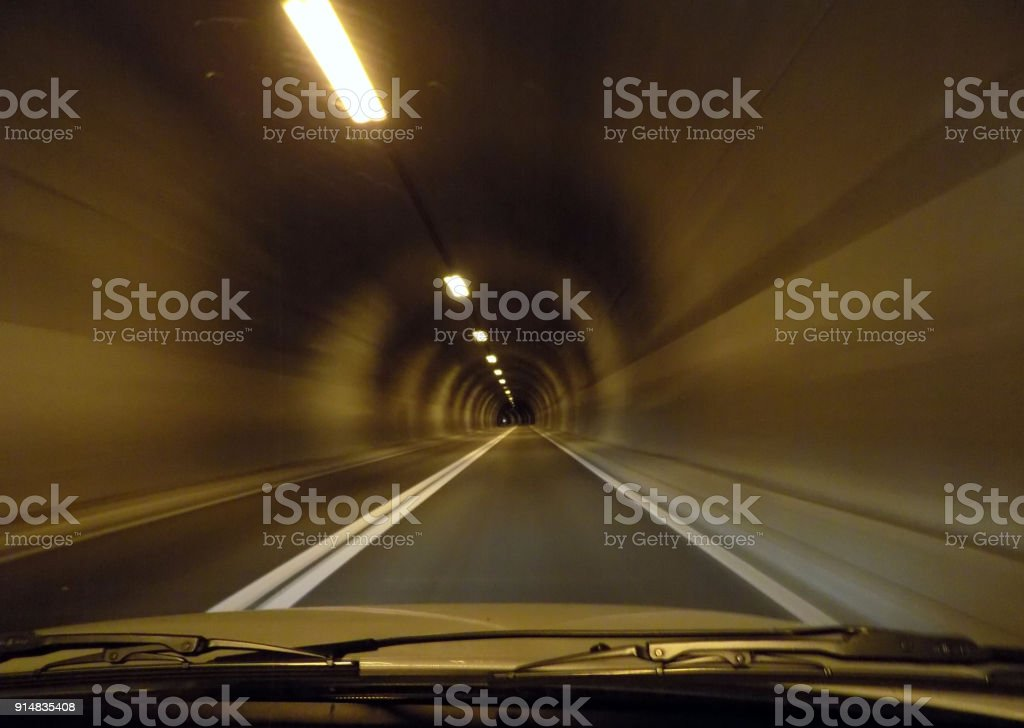 Drive through the tunnel, seen through the windshield glass