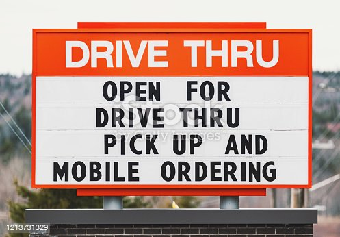 Fast food restaurant indicating drive thru & mobile ordering only.